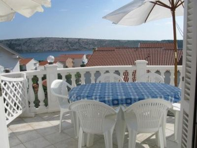 Photo for Two bedroom apartment with terrace and sea view Barbat, Rab (A-16816-b)