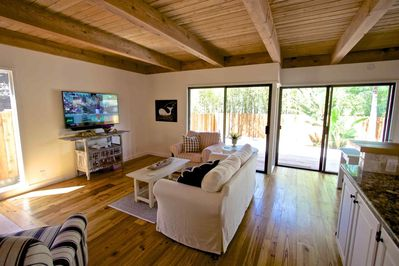 Beautiful wood beem ceilings and wood flooring give this cottage a warm and cozy feel