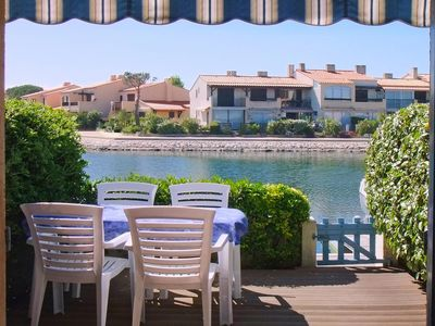 Photo for The charm of a blue marina overlooking the lagoon (Free Wi-Fi access).