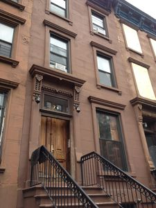 front of brownstone