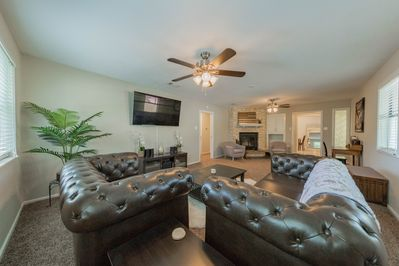 Living room area is extremely large with seating for 8.