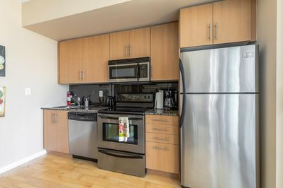 Stainless Steel Kitchen Appliances and Granite Counter Tops