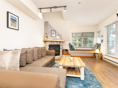 Photo for Happiness begins with a ski in/out stylish Whistler condo - pool,hot tub,views