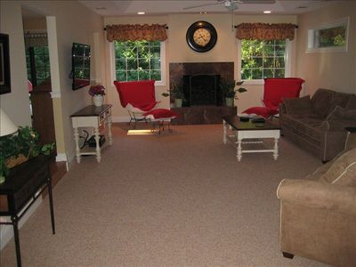 Completely renovated living room with two new windows overlooking the pool .
