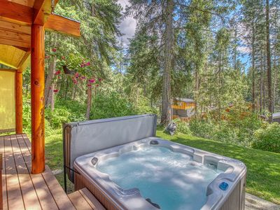 Photo for NEW LISTING! Great cabin w/ partial river views, hot tub & shared beach access