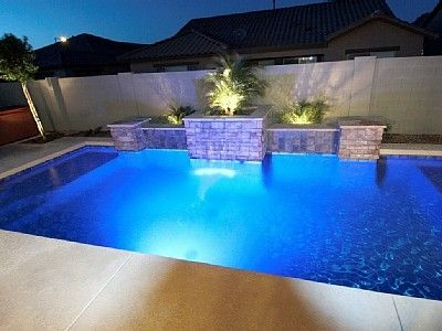 Heated Pool features color changing Light and Waterfall