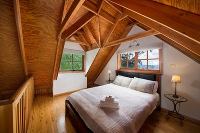Large main loft bedroom with views of the Kanimba valley