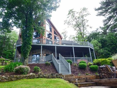 Lakefront home with dock slip, hot tub, fire pit and foosball table!