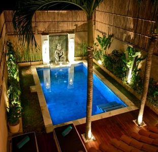 Private pool area with beautiful night lighting