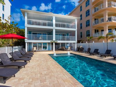 Photo for NEWLY RENOVATED Poolside Cabana. Located DIRECTLY on the beach check out video!