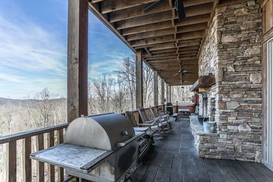 Covered deck with hot tub, fireplace and grill