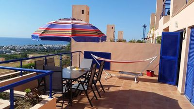 Photo for Homerez last minute deal - Nice apt with pool access and terrace