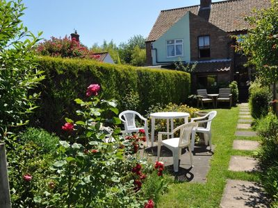 Photo for This delightful cottage located on Beeston Common, within walking distance of the town and beach