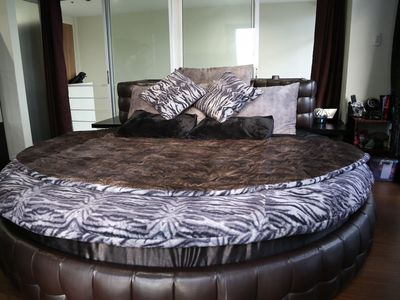 Photo for Large Round Bed in 2-Story Condo plus FREE Maid Service