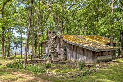 Escape to a lakeside getaway at this vacation rental cabin in Boyd's Branch Bay.