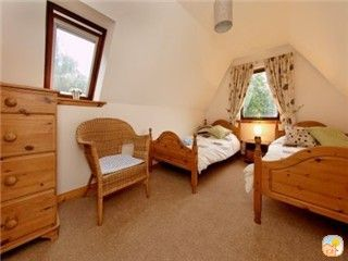 One of the twin bedrooms with loch views