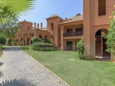 Photo for Stylish apartment for 4 people at Amendoeira Golf Resort