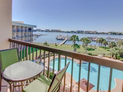 Photo for Bayfront studio with shared pool, dedicated dock, & gorgeous balcony view!