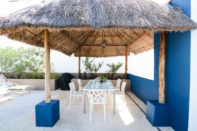 Rooftop dining under a traditional Palaypa & we have a BBQ too