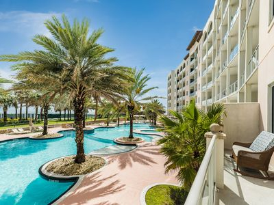 Photo for Waterfront condo w/ shared pools, hot tub, lazy river, & gym - steps to beach