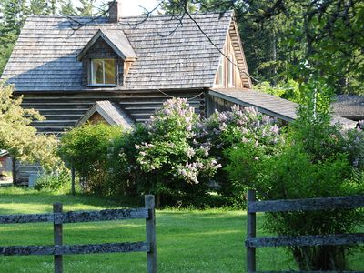 The log house is a beautifully restored heritage farm house built in 1907.