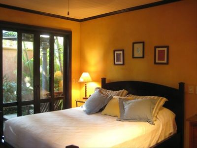 Master bedroom, with view of private courtyard.