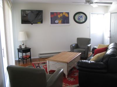 First floor living room, 40 inch TV with DVD and Wifi.  Hardfloors throughout.