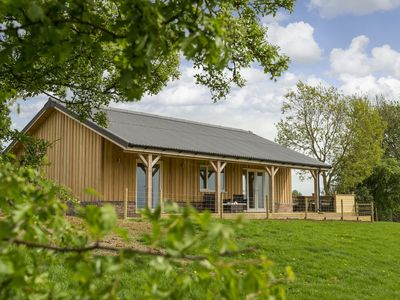 Photo for Situated 12 miles from the wonderful Rutland Water and on a working farm, Strawberry Lodge provides