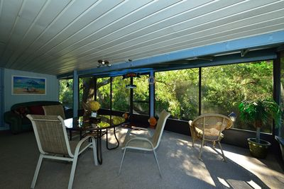 Large screened in porch over looking river