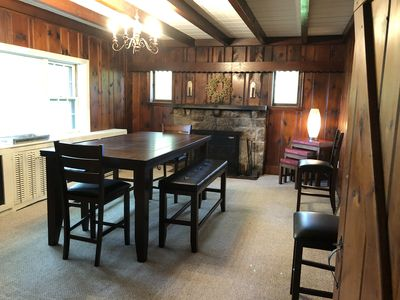 One of 3 Dining areas with fireplace and Bar