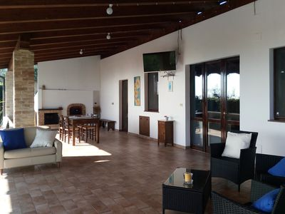 Photo for Private house with porch and garden, just steps from the beach