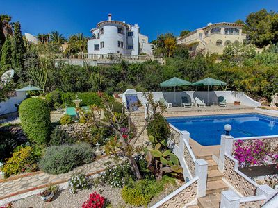 Photo for Villa Zorzal is a family-friendly villa, with air con and wifi in El Portet, a lovely pool and prett