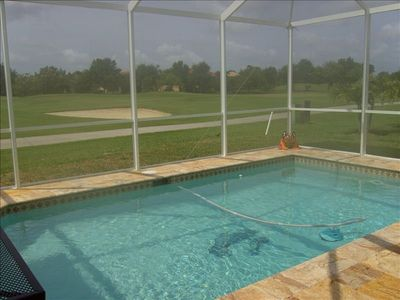 view of heated pool and golf course