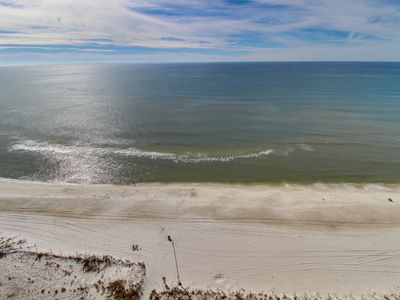 Photo for NEW LISTING! Beachfront condo with a views and a shared hot tub and pools!