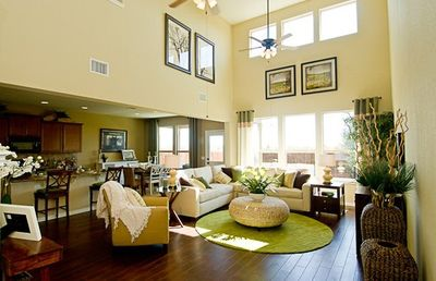 Open living room w/ 40' ceilings. Central AC & fans. Furnishings may change.