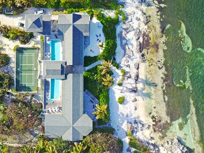 Amoraflora: Oceanfront Micro-Resort Villa with 80' Pool + Pickle-Ball Court in Famous Rum Point