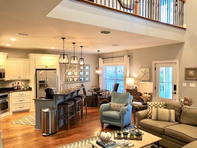 Tastefully decorated open concept Living Room and Kitchen.