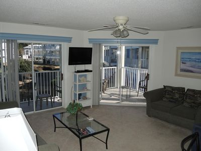 Photo for Spacious one bedroom condo with full length balcony, living room, kitchen, and a washer/dryer!  (308M)