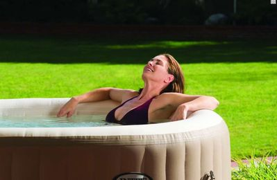 Relax in the beautiful 4-6 person outdoor hot tub