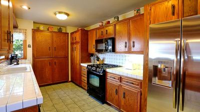 Well equipped kitchen for six. Gas BBQ on patio and pass through window to patio