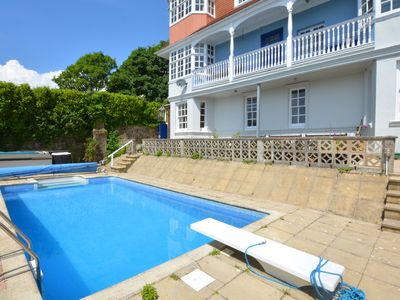 Photo for Apartment with sunny terrace, beautiful view and heated pool