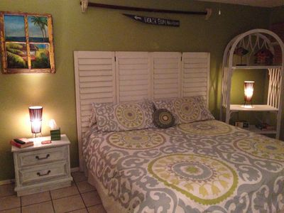 Comfy King Size Bed with Tropical Rustic Décor Sink area is separate from bath