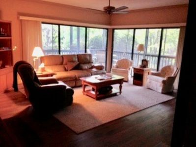 Living area opens to large L-shaped screened porch enhancing your mountain stay