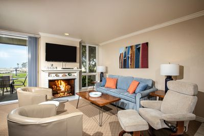 The ocean and harbor-view living area of Seaside Cottage is light & airy and inviting!