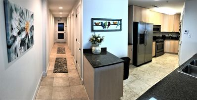Entrance & kitchen. Granite counters and stainless appliances.