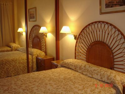 Photo for Seville vacation apartment with private garage. Internet WI-FI and POOL