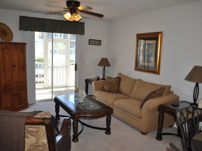 Photo for Affordable cozy 2 bedroom condo 1st floor screened in patio in gated communty