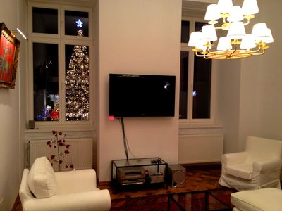 Living area with 3 seat couch, two armchairs, 50' plasma TV, DVD set, etc. Note the beautiful view of the Christmas tree from Piata Sfatului.