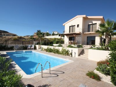Photo for A first class private 3 bedroom villa with pool,landscaped garden and sea view.