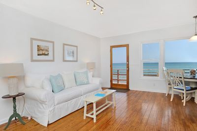Oceanfront living area with pegged hardwood floors throughout